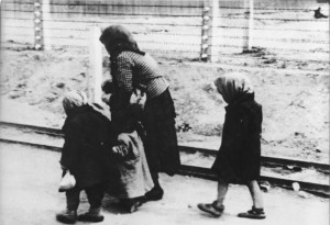 Victims on the way to the gas chambers. Auschwitz
